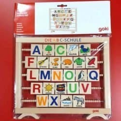 A wooden alphabet learning toy in German language.